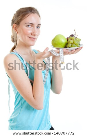 smiling young woman with fruits, concept of diet - stock photo