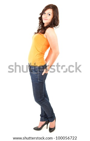 smiling young woman with hands in pocket, full length, white background