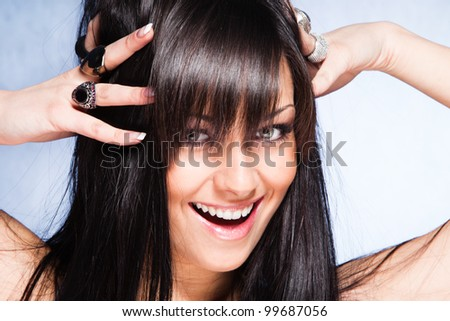 smiling young woman with healthy and shiny long  hair - stock photo