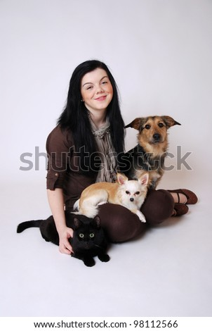 smiling young woman with her pets