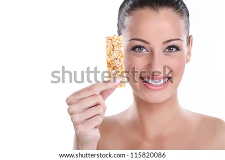Smiling young woman with muesli bar,  healthy eating - stock photo