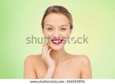 smiling young woman with pink lipstick on lips - stock photo