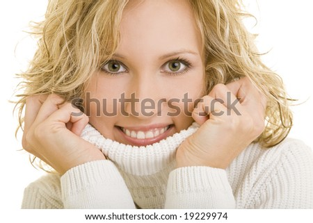 Smiling young woman with turtleneck sweater - stock photo