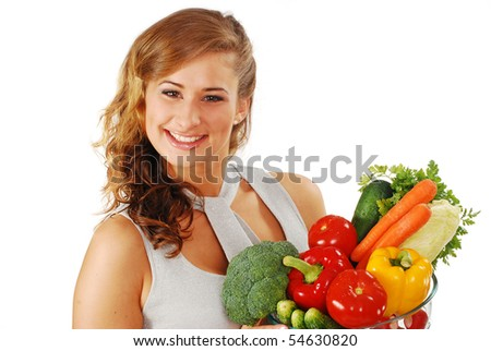 Smiling young woman with vegetables