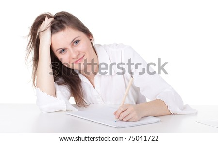 smiling young woman writing or painting on blank card - stock photo