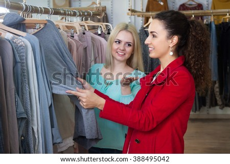 Smiling young women shopping jersey at the apparel store