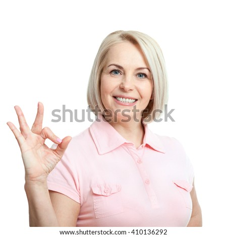 Smilling attractive middle aged woman showing thumbs up, okay. Isolated square