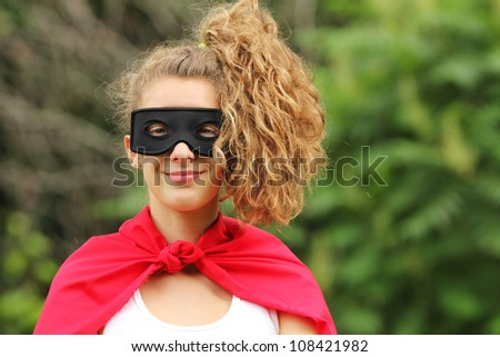 smilling young woman with pony tail wearing a red super hero kit