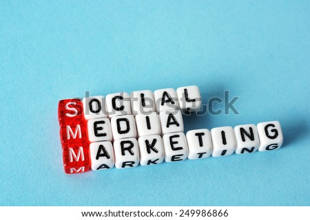 SMM Social Media Marketing definition  acronym on blue - stock photo