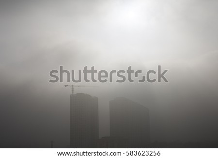 Smog and dust in the polluted air in an Asian city.