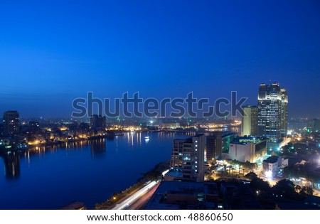 Smoggy evening panorama across Cairo in Egypt with the river Nile - stock photo