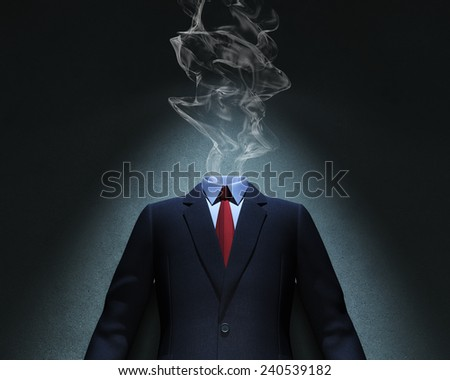 Smoke and suit in spot of light - stock photo
