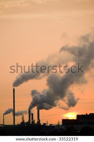 Smoke coming from chimneys at sunset