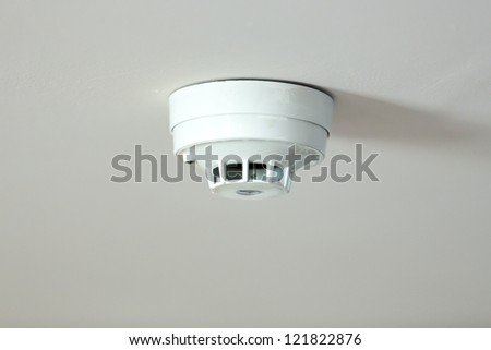 smoke detector located on the roof of a house - stock photo