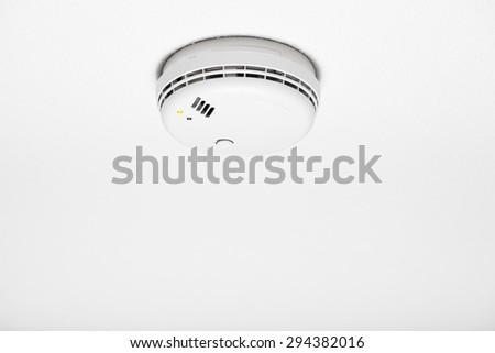 smoke detector of fire alarm, white background - stock photo