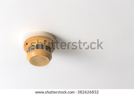smoke detector on a ceiling