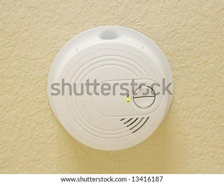 Smoke Detector on finished ceiling - stock photo