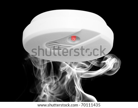 Smoke detector with smoke - stock photo