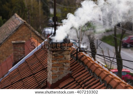 Smoke from a chimney  - stock photo