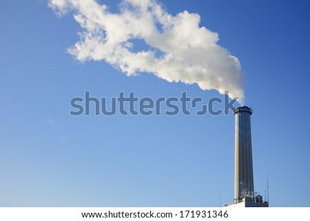 Smoke from a high smokestack - stock photo