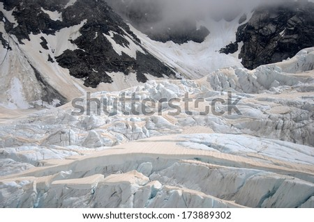 Smoke from bushfires in Australia causes brown discolouration on the snow of the Franz Josef Glacier, Westland, New Zealand.