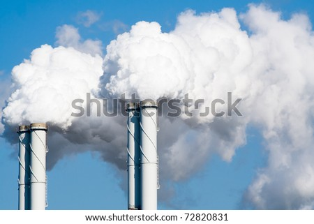 Smoke from factory pipes - stock photo