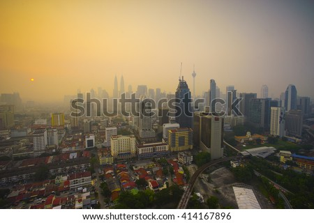 Smoke from forest fires in Indonesia blows across the Malay Peninsula causing haze in Kuala Lumpur - stock photo