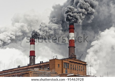 Smoke from pipes. Air pollution. - stock photo