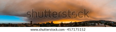 Smoke from Sand brush fire covering West Hollywood cityscape at sunset. Los Angeles, California, July 24, 2016. - stock photo
