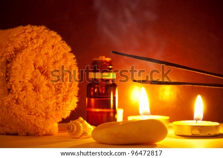 Smoke from scented sticks, towel, candles and essential oil bottle - stock photo
