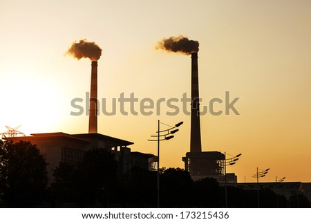 Smoke from the chimney at dusk - stock photo