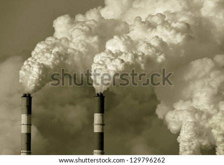 Smoke from the pipes of heat station - Moscow (stylized retro) - stock photo