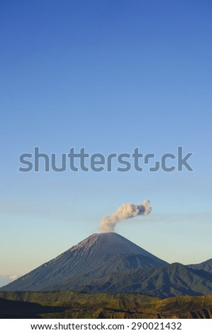 Smoke from Volcanoes in Bromo Tengger Semeru National Park - stock photo