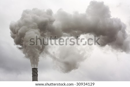 Smoke going from chimney on clouds background