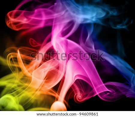 Smoke in the maelstrom of the rainbow on a black background. - stock photo
