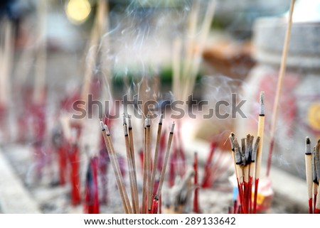 smoke incense in shrine - stock photo