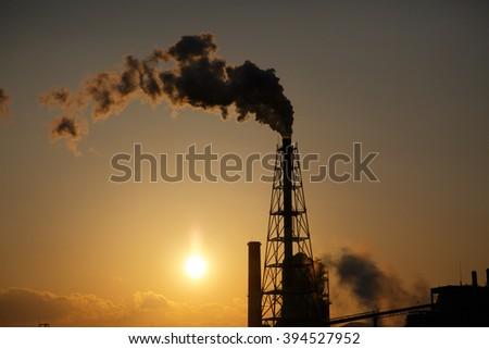 Smoke of a chimney - stock photo