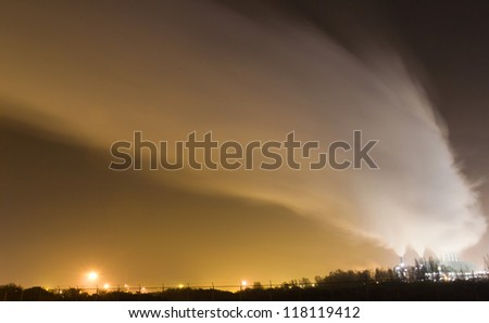 Smoke originating from a large industrial plant - stock photo