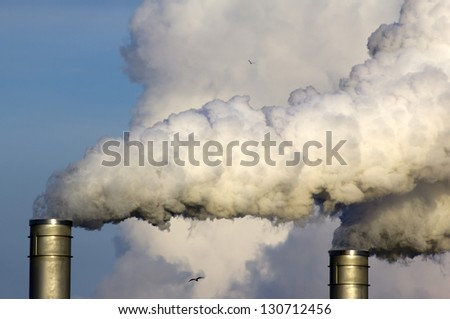 Smoke originating from a large industrial plant