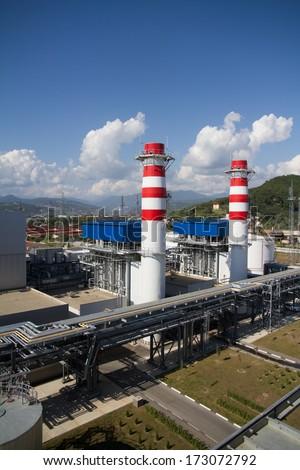 smoke pipes of power plant - stock photo