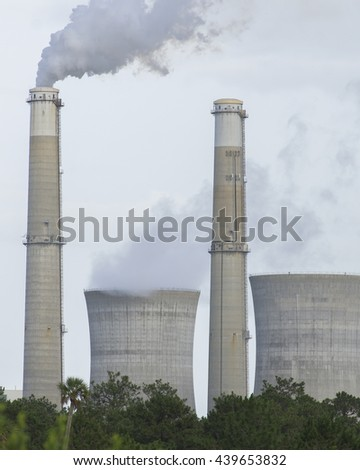 Smoke pouring out of Chimney/Power Station/Electrical power generating plant  - stock photo