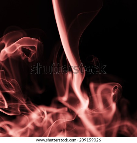 Smoke shapes on black background