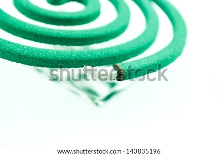 Smoke spiral usable against mosquitoes and other insects - Burning mosquito coil as anti insect - stock photo