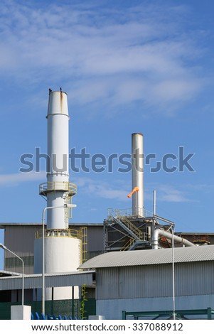 Smoke stack of industrial factory with sky