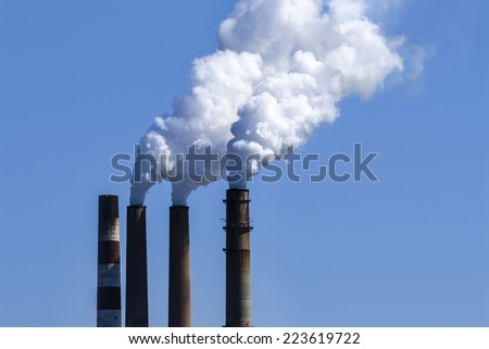 Smoke Stack Sky  - stock photo