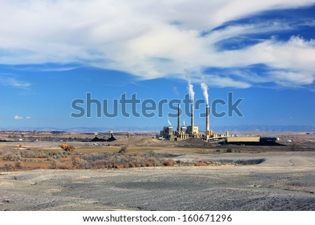 Smoke stacks and a power plant in the Utah desert, USA. - stock photo