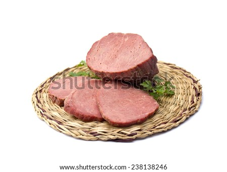 Smoked beef on a wicker stand. Isolated on white background - stock photo