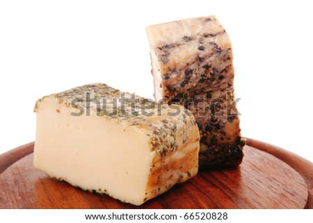smoked cheeses on wood on white background