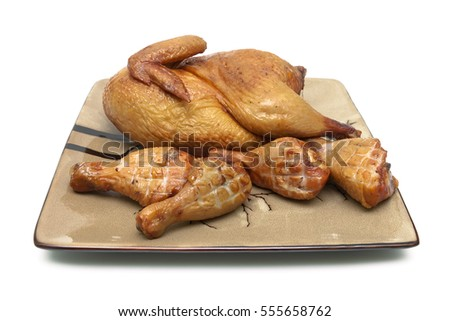 smoked chicken and grilled chicken legs on the plate. white background - horizontal photo.