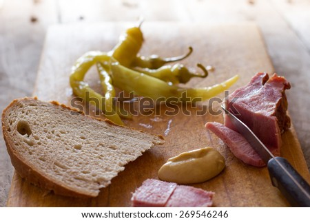 Smoked meat on a cutting board - stock photo
